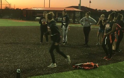 This year's powderpuff team practices for their November 1st game. This year's contest will be played at Woodbridge High School's Nicholas A. Priscoe Stadium. (Photo taken from Mr. Switek's twitter account @WHSSwitek)